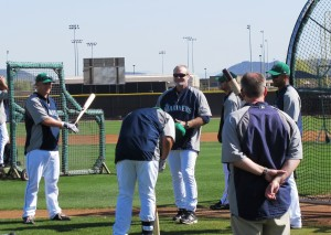 L-R Kyle Seager, Kendrys Morales (bending), Eric Wedge and Franklin Guttierez
