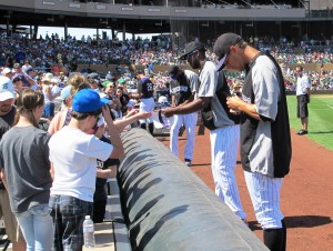 Rockies players signing autographs