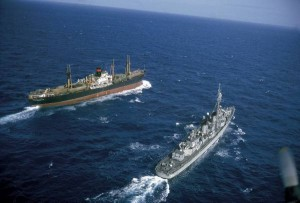 U.S. warship approaching Soviet freighter on sea lanes to Cuba