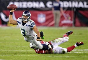 Russell Wilson tosses a miracle...