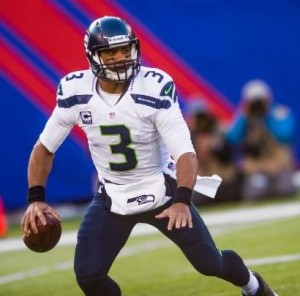 Russell Wilson look for a receiver