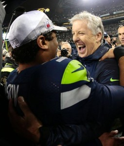 Russell Wilson and Pete Carroll celebrating NFC Championship