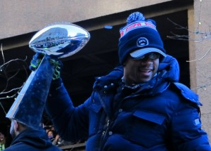 Russell Wilson hoists the Lombardi Trophy at Seahawks Victory Celebration in downtown Seattle...photo by Mark Arnold