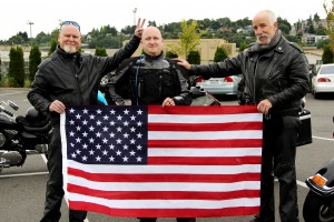 "Our ""Intrepid Trio"" holding the flag"