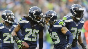 Hawks defensive stalwarts-Sherman (25), Thomas (29) and Chancellor (31)
