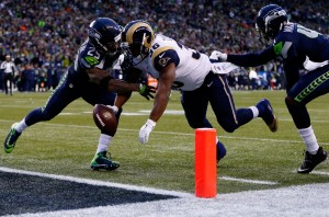 Earl Thomas knocks the bll loose from the Rams Benny Cunningham