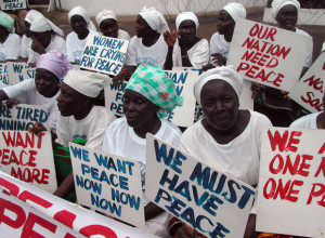 Muslim and Christian Liberian women protesting for peace