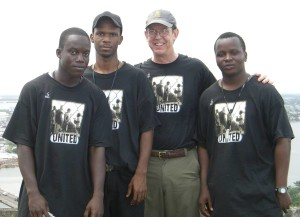 Jay Yarsiah (left center) and Tim Bowles (right center) working for human rights in Liberia