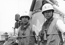 Captain John Herrick (left) on the USS Maddox