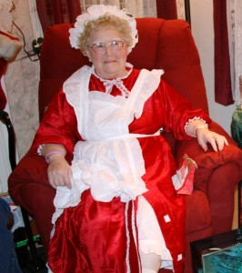 """"""" She appeared to be about 70 years old and was dressed entirely in red. She had a lace hat on her head, rosy cheeks, a twinkle to her eye, and a big grin was etched across her face."""""""